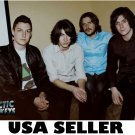 Arctic Monkeys sitting simple brown bkgrnd POSTER 34 x 23.5 British band