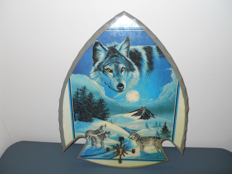 arrowhead shaped handmade wall clock - features wolves