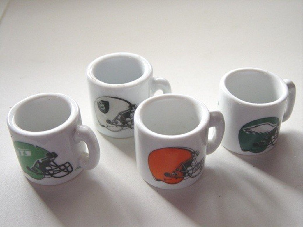 Four Minature Football Mugs Eagles, Browns, Jets, Raiders #300688