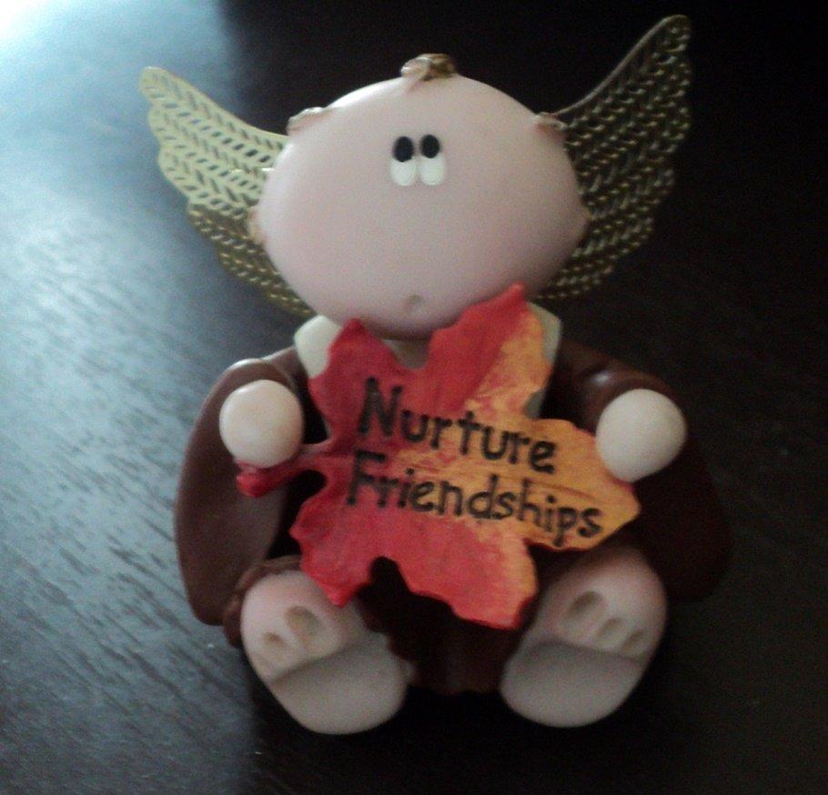 Russ Berrie Angel Cheeks Figurine Holding Colored Leaf Entitled Nurture Friendships #302263