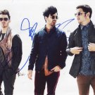 The Jonas Brothers in-person autographed group photo