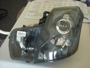 03-07 Cadillac CTS Driver side Headlight (LH)