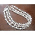 TB371  Three Stranded White Pearls & Genuine Swarovski Moonlite Crystals Bracelet