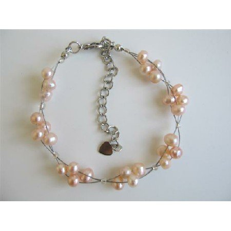 TB602  Peach Freshwater Pearls White Pearls 3 Stranded Wire Bracelet