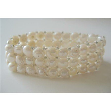 TB361  Three Stranded Cream Freshwater Pearls Stretchable Bracelet