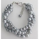 TB1148  Tripple Strand Silver Pearl Gray Pearl Bracelet At Amazing Price