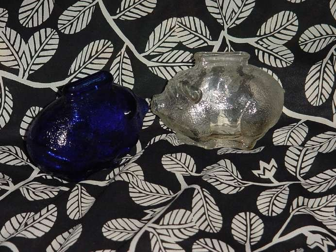 Two piggy banks one cobalt Blue one white Glass iridescent ban