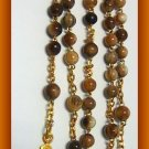 VINTAGE CATHOLIC ROSARY DARK BONE WITH GOLD PLATED CROSS AND CENTER