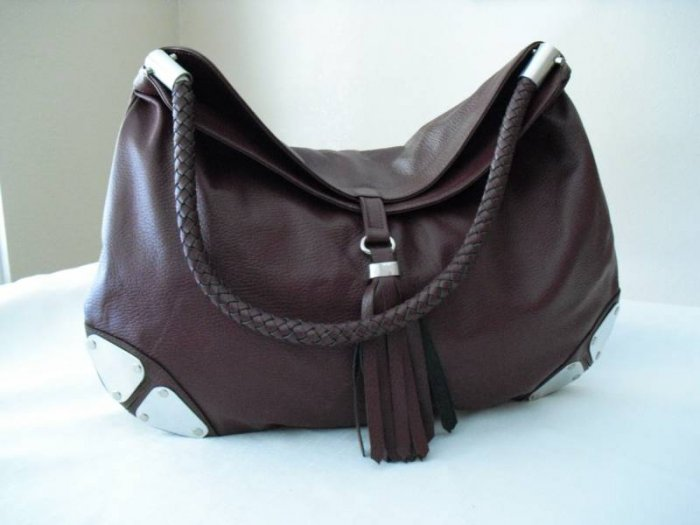 Wine Hobo Leather Handbag with metalic details.