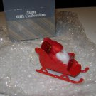 "Avon Christmas Ornament "" Santa on a Sleigh "" metal"