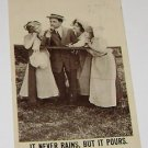 "Vintage Postcard  ""It Never Rains But It Pours"" Man WIth Three Women"