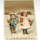 """Vintage Postcard """"A Merry Christmas to you"""" 2 little girls w/gifts early 1900's"""