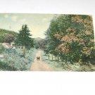 Vintage Postcard  Old car going down dirt road 1915 PM'd