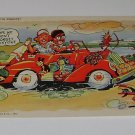 Vintage Postcard Comedy Man Woman in Red Convertible Car full of Souvenirs