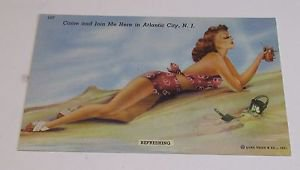 "Vintage Postcard Atlantic City ""Girl in two piece bikini laying on beach"""