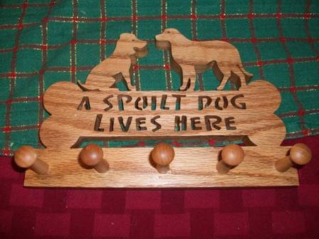 A Spoilt Dog lives here wood mug holder