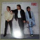 HUEY LEWIS   autographed    SIGNED   #1  RECORD  !