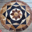 628 COWHIDE HAIR-ON LEATHER PATCHWORK RUG 48IN DIA