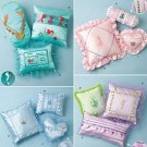 Simplicity 2385 Decorative pillows in seven sizes shown with Disney trim.