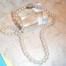 Vintage simulated 1940's pearls with rose clasp