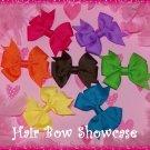 A Seven Piece Pinwheel Baby Bow Collection