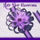 A Purple Flower Hair Bow Holder