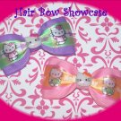 A Fun and Fabulous Set of Hello Kitty Baby Tuxedo Hair Bows