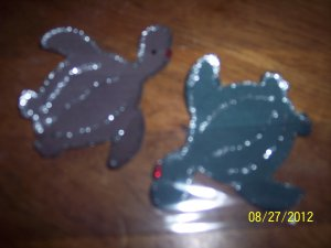 pair of turtles one green and one brown