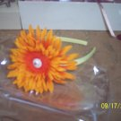 headband with orange gerber daisy