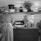 WOMAN IN KITCHEN PHOTO VINTAGE DISHES SINK PLANTS MARION POST WOLCOTT DRESS DISHES
