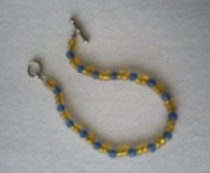 Handcrafted Beaded  Bracelet in Blue/Yellow, 7""