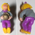 VINTAGE CHARACTER RUBBER PLASTIC PENDANT GIRL CARRYING