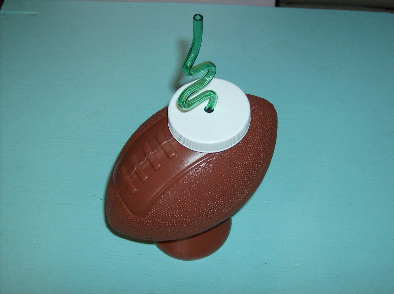 BRAND NEW FOOTBALL SHAPED DRINKING CONTAINER WITH STRAW
