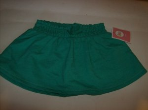 BRAND NEW GREEN SKIRT SIZE 12M  WITH ELASTIC WAIST BAND