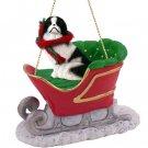 SLD110A Japanese Chin, Black & White Sleigh Ride Ornament