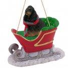 SLD15F Cocker Spaniel, Black & Tan Sleigh Ride Ornament
