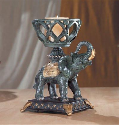 Elephant With Upraised Trunk Candle Holder.