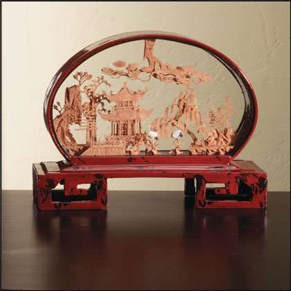 Carved cork scene in marbled red lacquer frame