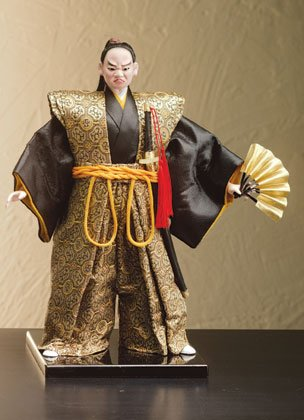 Samurai figure with fan and sword