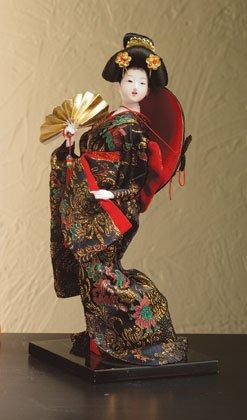 Porcelain geisha with fan.