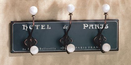 Hotel de Paris coat hanger with three ball-topped hooks