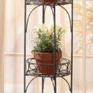 Antique two-tier metal planter shelf with verdigris finish