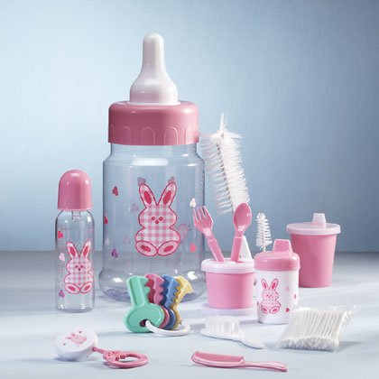 Pink 10-piece baby gift set in a bottle savings bank.