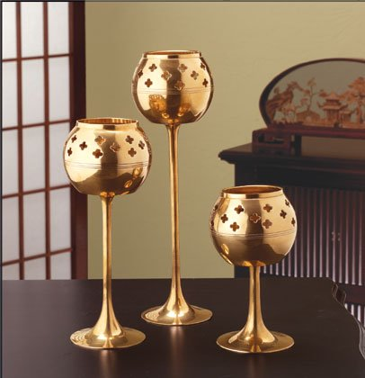 Candle holders with star cut-outs