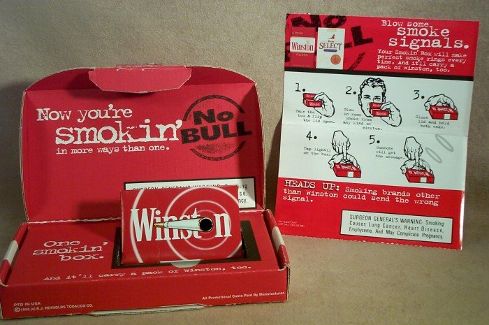 Advertising WINSTON Cigarette - This box is Smokin' - Blowing Smoke Rings - Contains No Tobacco