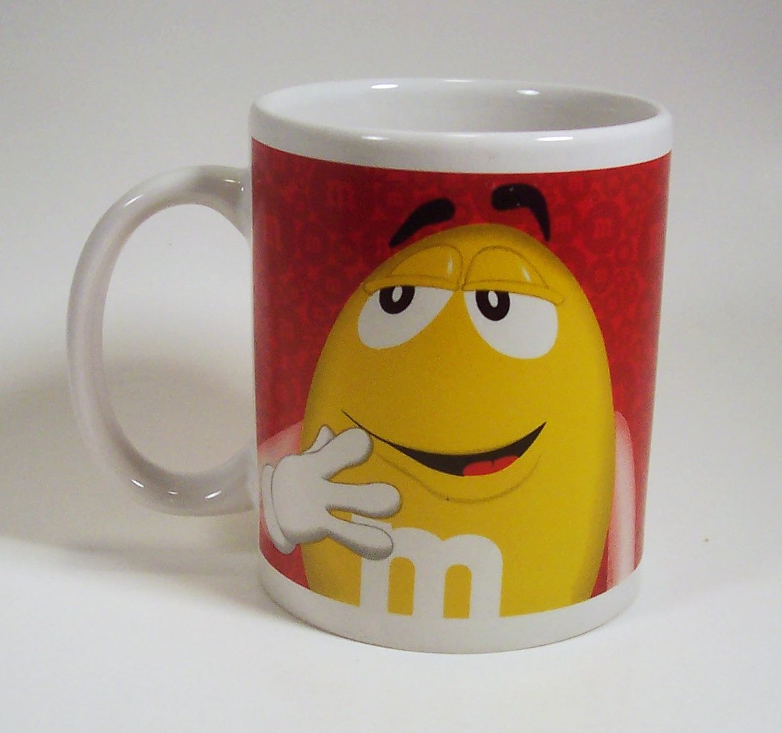M&M Mug with Red and Yellow M & M Characters on red background 2014