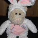 Plush tan Bear Dressed in a white Rabbit outfit from StarBucks Coffee