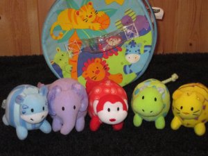 Early Years Case with five plush Animals with Rattles and Squeakers