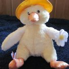 Commonwealth Yellow Plush Duck wearing a rain hat holding a flower with a butterfly on its foot
