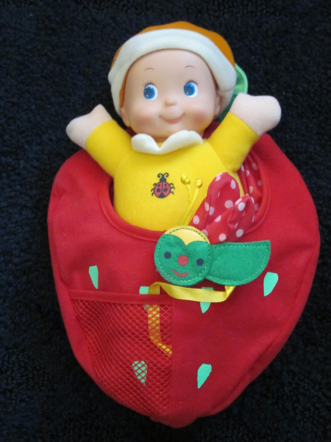 City Toys Doll with lady bug tucked in a Strawberry